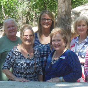 Picture of Kathy Boeckman and guests at bunkhouse open house