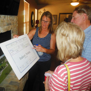 Picture of guests signing in for bunkhouse open house
