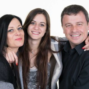 Picture of parents with teenage daughter smiling